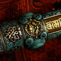 Tibetan healing stick, and c the image of Vajrapani mantra Om Mani Padme Hum